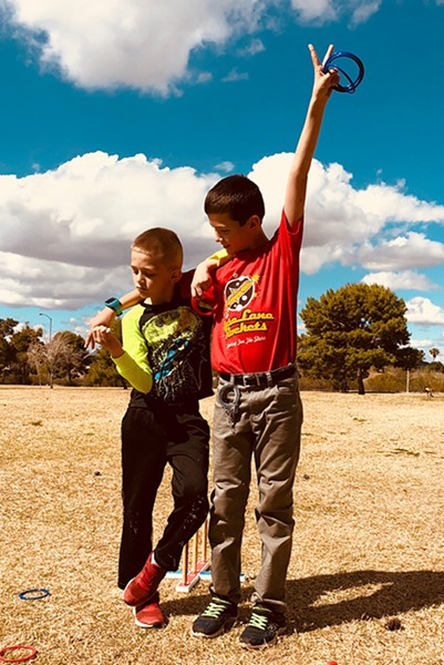 Jayden and Tristan on the day they reunited after being legally separated and adopted by different families. - COURTESY OF BRIAN HATFIELD