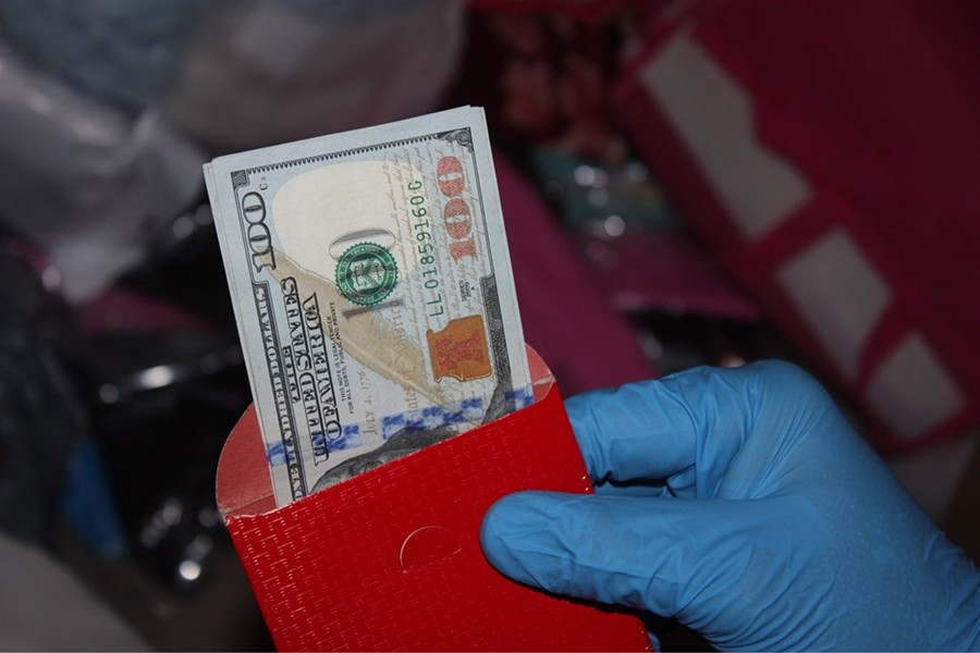 Money found during execution of a search warrant on the home of Amanda Yamauchi in Bullhead City. She was accused of sex trafficking, operating a house of prostitution, money laundering and six other felony crimes, although all charges were later dropped. (Photo by Bullhead City Police Department)