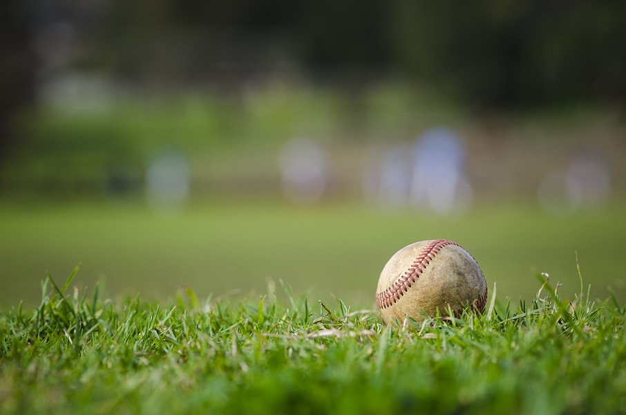 bigstock-used-baseball-on-fresh-green-g-93325931.jpg