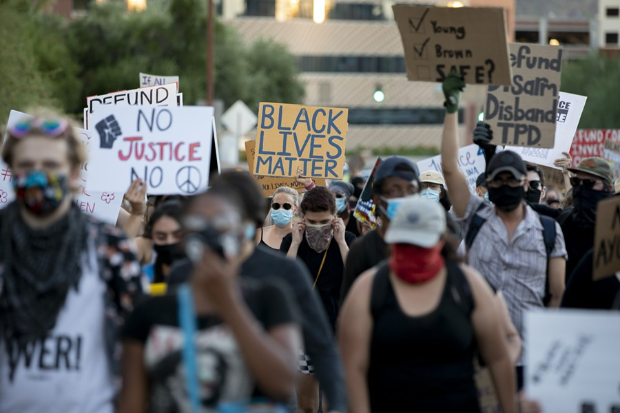 With hundreds of protesters behind her, Betters lead the protest through Downtown Tucson before making her way back to Catalina Park. - JOHN DE DIOS