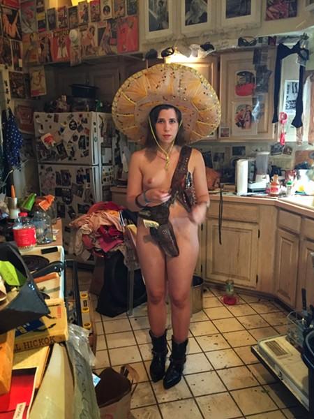 Melanie King in Eric Kroll's Tucson kitchen. - BRIAN SMITH