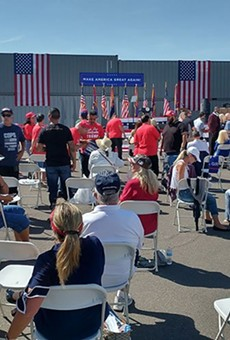 A crowd gathers at TYR Tactical in Peoria in advance of a campaign event by Vice President Mike Pence on Thursday – the same day Democratic challengers Joe Biden and Kamala Harris arrived in the Valley.