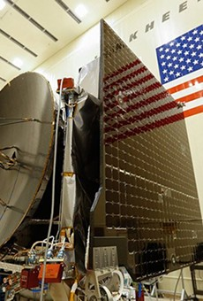 """Final assembly in 2015 of the OSIRIS-REx spacecraft, which launched in 2016. University of Arizona teams had been working on the project for more than a decade when it reached a near-Earth asteroid, Bennu, this week and executed a touch-and-go mission to briefly """"tag"""" the surface, collect soil samples and head back to orbit."""