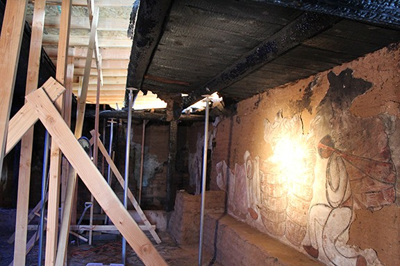 One of the damaged frescos and reconstruction equipment in the DeGrazia chapel.