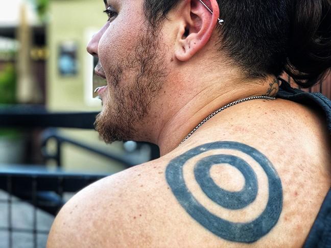 A Cain tattoo, circles of life. - BRIAN SMITH