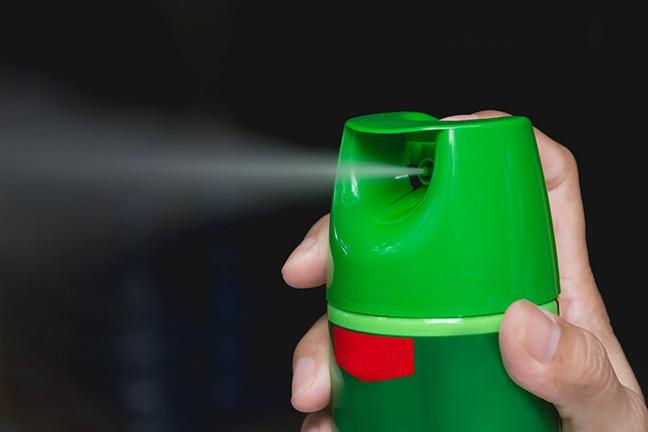 bigstock-hand-holding-mosquito-spray-h-232861351.jpg