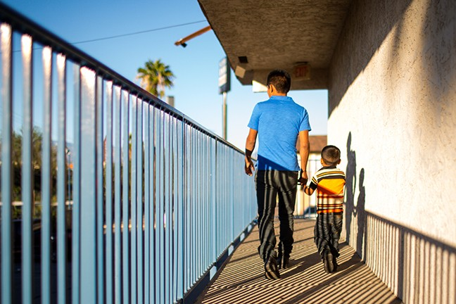For some of migrants who were lodged at the Tucson motel, it was the first chance to connect with loved ones left behind in Central America. - PHOTO BY NICOLE NERI/CRONKITE NEWS