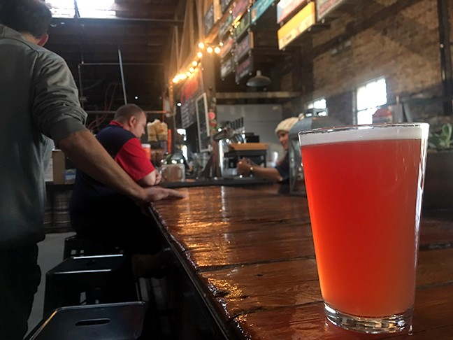 The Prickly Pear Wheat at Borderlands Brewing Company has a rosy red hue and a light, bready flavor highlighted by the crisp sweetness of prickly pear.