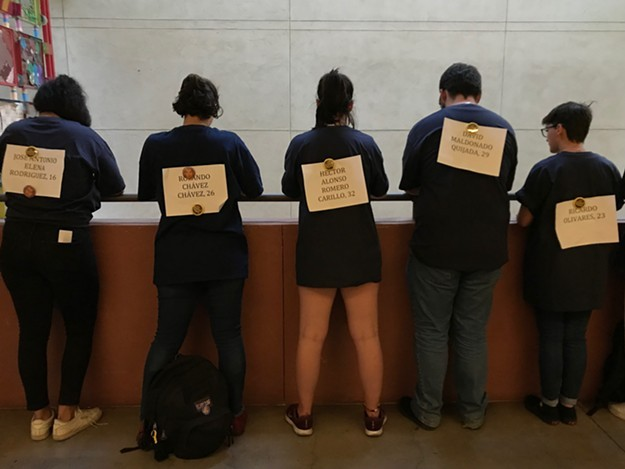 Protestors display the names of people killed at the U.S.-Mexico border.