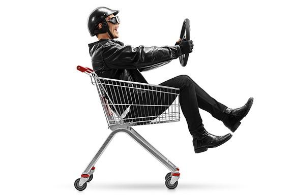 bigstock-biker-riding-in-a-shopping-car-206000686.jpg