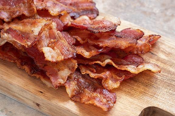 bigstock-cooked-greasy-bacon-on-a-wood--296855854.jpg