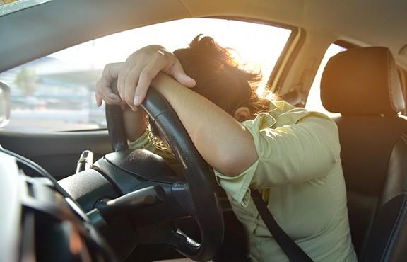Woman asleep on wheel