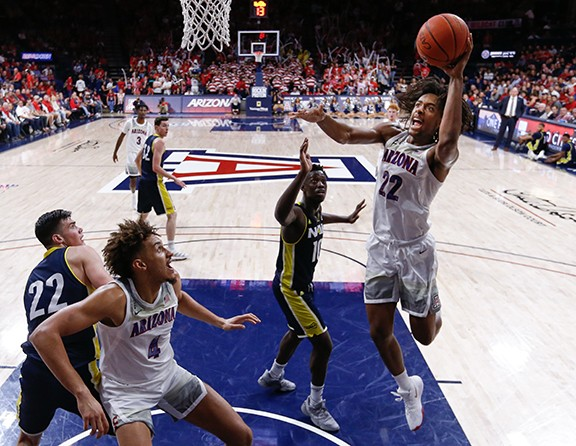 Arizona freshman forward Zeke Nnaji (22) scores a layup against Northern Arizona University Wednesday, Nov. 6. Nnaji had a game-high 20 points on 9-of-12 shooting for the Wildcats.