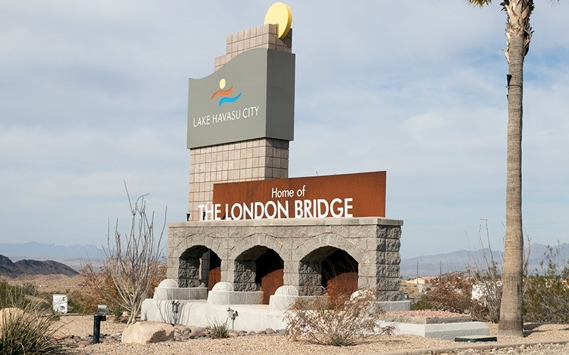 A welcome sign proclaims Lake Havasu City as the home of the London Bridge, which was transported to western Arizona and reconstructed in 1968. Havasu was the backdrop of a sex-trafficking investigation that ultimately fell apart in December 2019. (Photo by James Paidoussis/Howard Center)