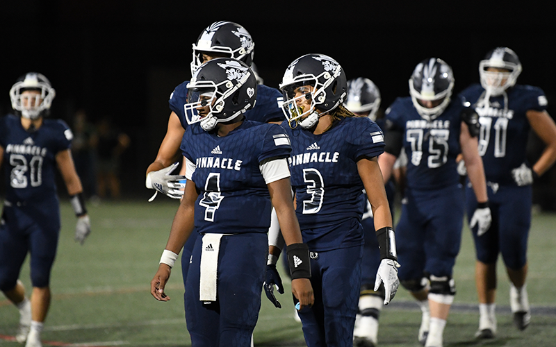 The COVID-19 pandemic has caused havoc with high school football team's ability to practice and has led to some surprising blowouts. Traditional powerhouse Pinnacle High lost 64-0 to Chandler. - PHOTO BY KEVIN HURLEY/CRONKITE NEWS