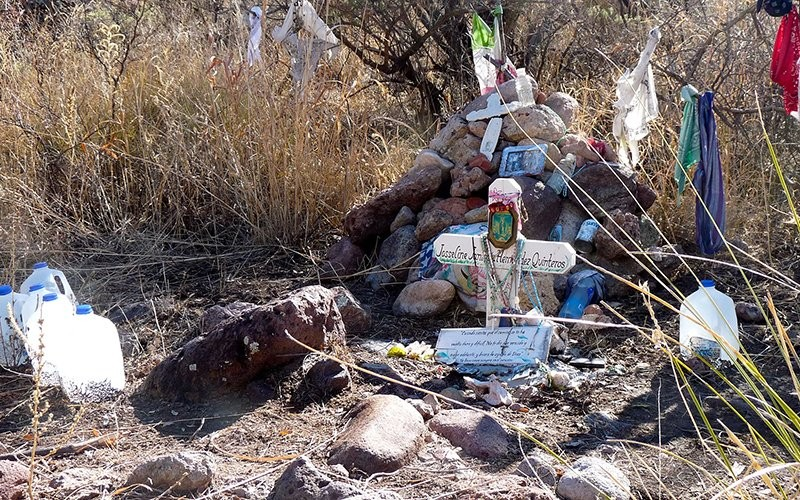 A makeshift memorial in 2011 at the site where a migrant teen's body was found in Arizona. Remains found in the desert through the first three quarters of this year have already exceeded all of 2019, and are at the highest rate since 2013, a new report says. - BOB GAFFNEY, CREATIVE COMMONS