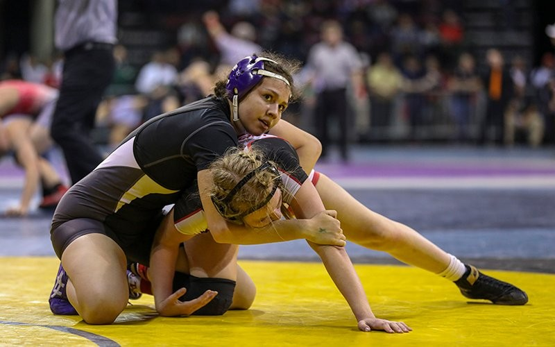 Isabelle Munoz of Casteel (top) works to turn Adacelli Noriega of Bisbee in the state finals of the 2020 AIA girls wrestling state championship match at 118 pounds. Girls don't compete for a team title yet but could in the future. - TRAVIS WHITTAKER/CRONKITE NEWS