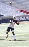 Arizona junior Khalil Tate leads the Wildcats through practice on Tuesday, Aug. 7.