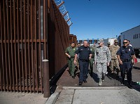 SPEC. HOSANNAH VICKERY/U.S. ARMY - Customs and Border Protection Port of Nogales Director Michael Humphries, in blue, briefs Air Force Gen. Terrence J. O'Shaughnessy, during a tour of the border at Nogales on Nov. 7, shortly after active-duty troops arrived there.