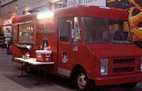 HEATHER HOCH - The bright red Bam Bam truck is parked outside of Rialto Theatre Thursday through Saturday nights.